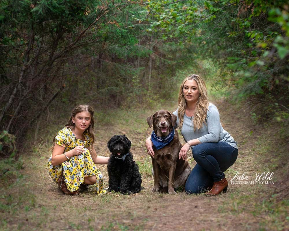 mother daughter and two dogs portrait in Post Falls outdoor studio photographer luba wold in yellow dress and blue top