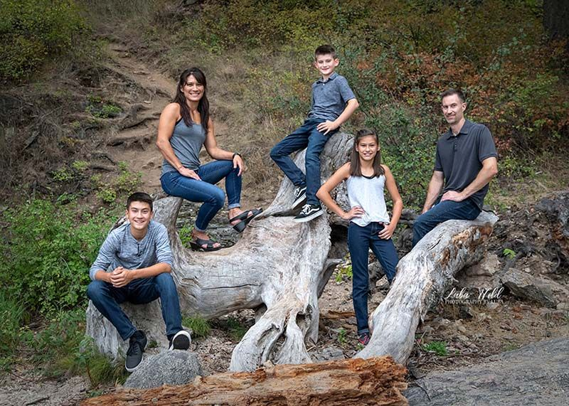 spokane family of five in grey and blue tone colors on Tubbs Hill in Coeur d' Alene photographer luba wold