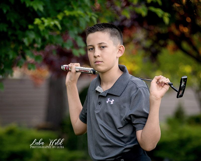 sport photography golf boy holding a club photographer luba wold coeur d alene