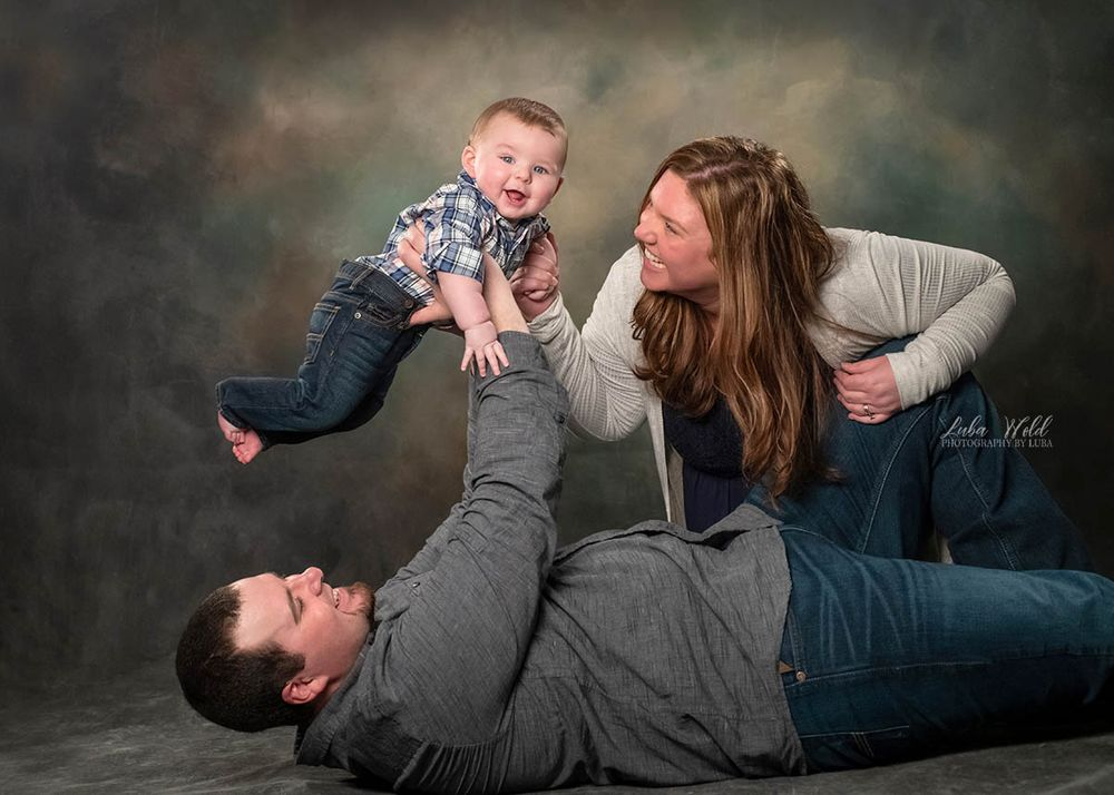 post falls Idaho studio family of three playing with a baby photographer luba wold