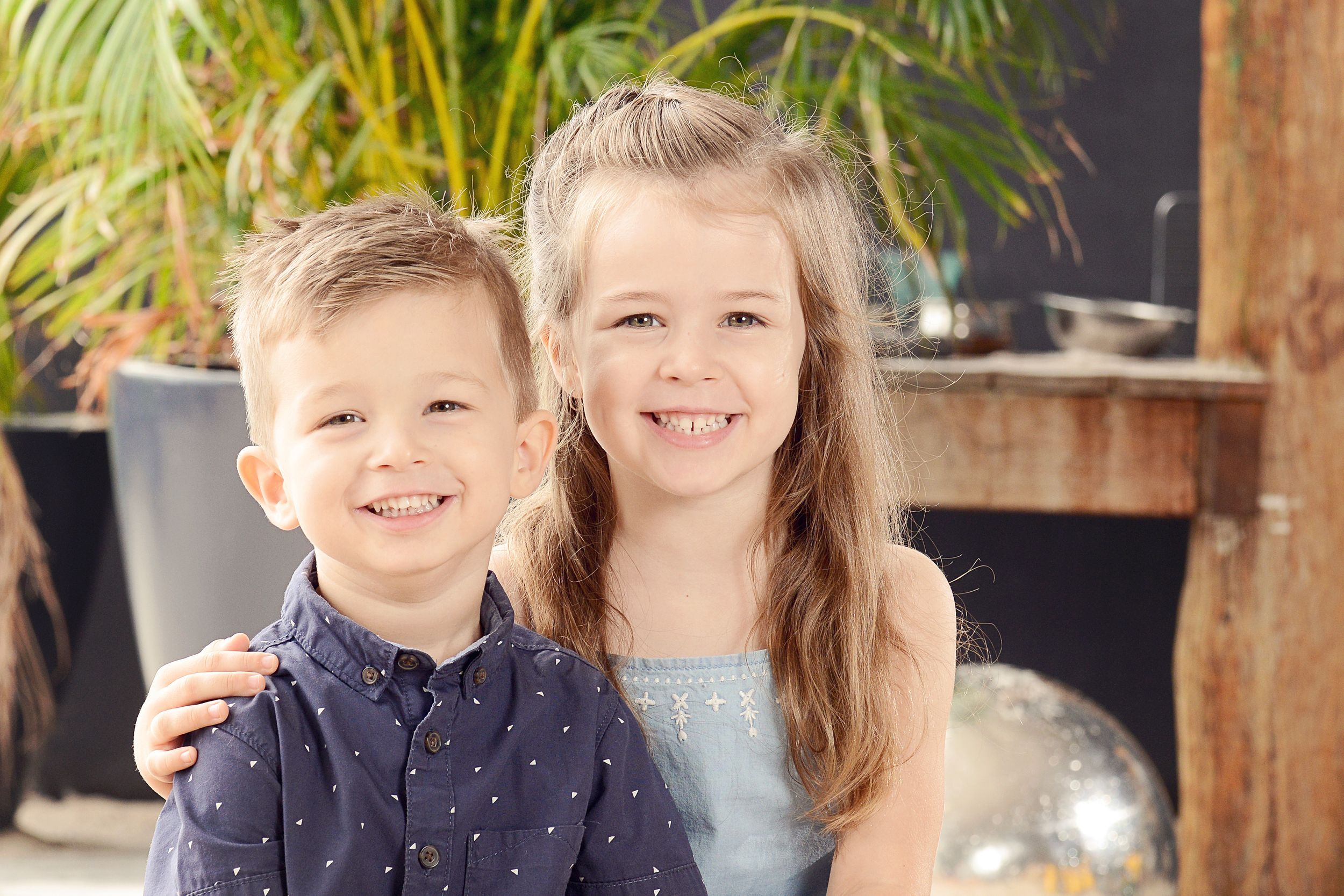 Brother and sister smile for kindy photo