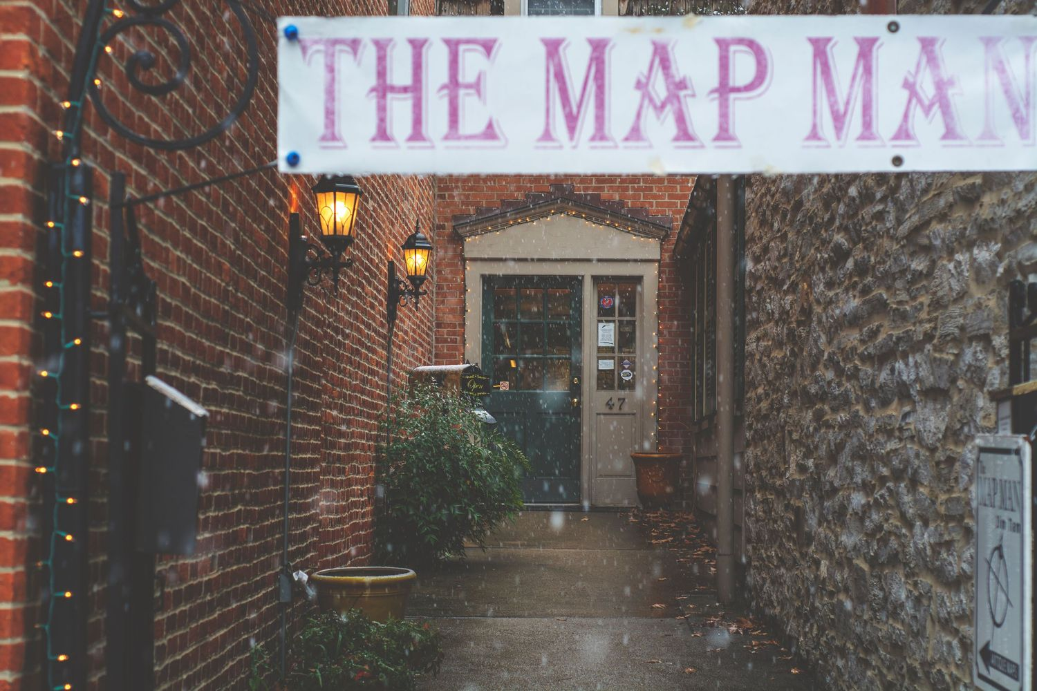 A small alley that leads to a shop called The Map Man.