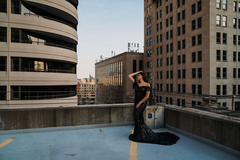 beautiful woman in black ball gown overlooking the city of cincinnati portrait photography ohio senior dayton