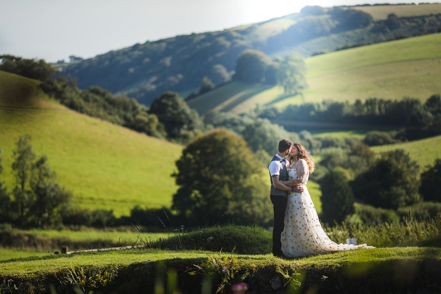 bride and groom with beautiful countryside behind them