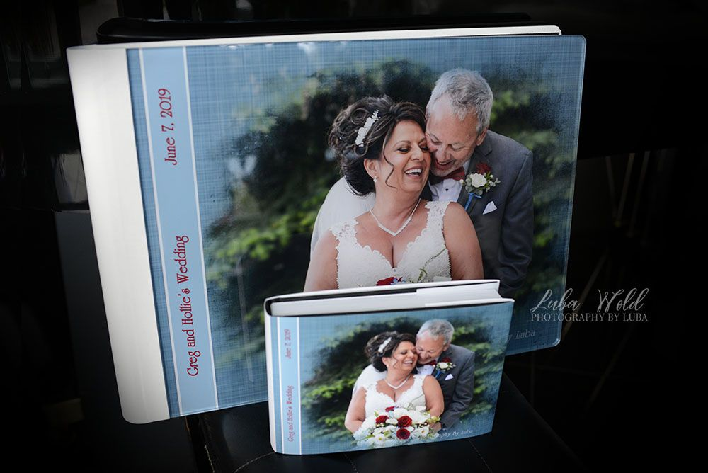 spokane wedding and parent book and photographer luba wold with cover of a couple laughing and kissing at Hagadone Event