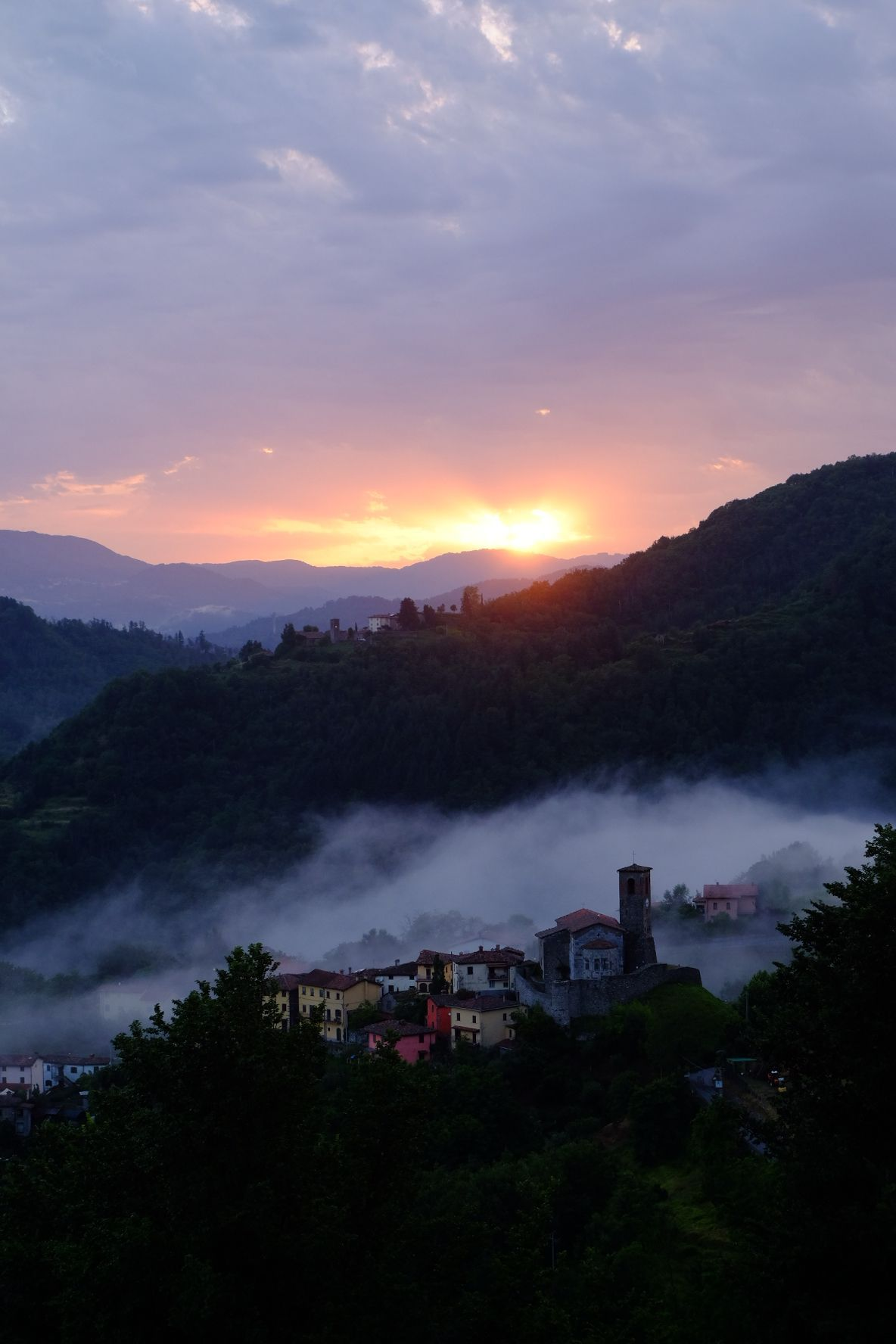 Sunsetting on small hilltop village in Northern Tuscany
