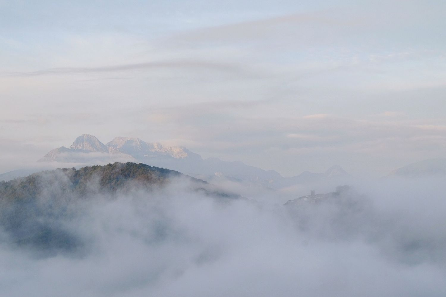 clouds hang in the valley in Garfagnana