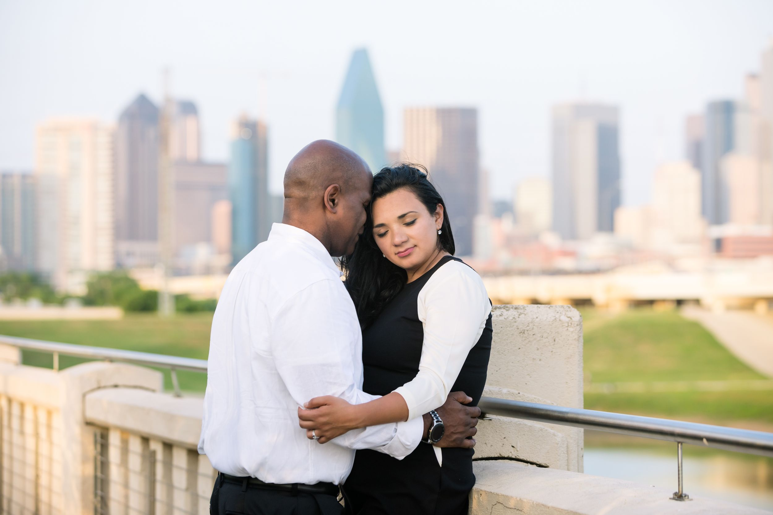 A couple gets engaged at the bridge at Trinity Groves.