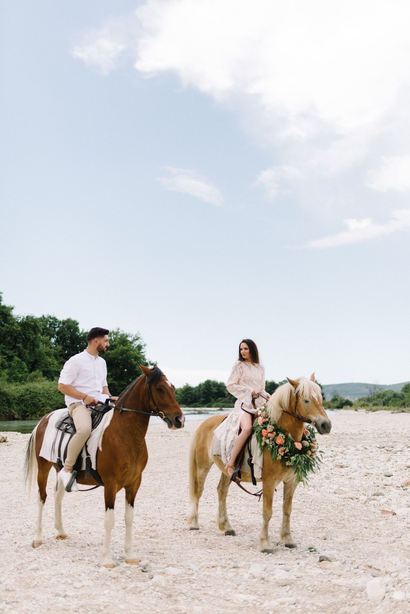 couple riding horses in acheron river in greece