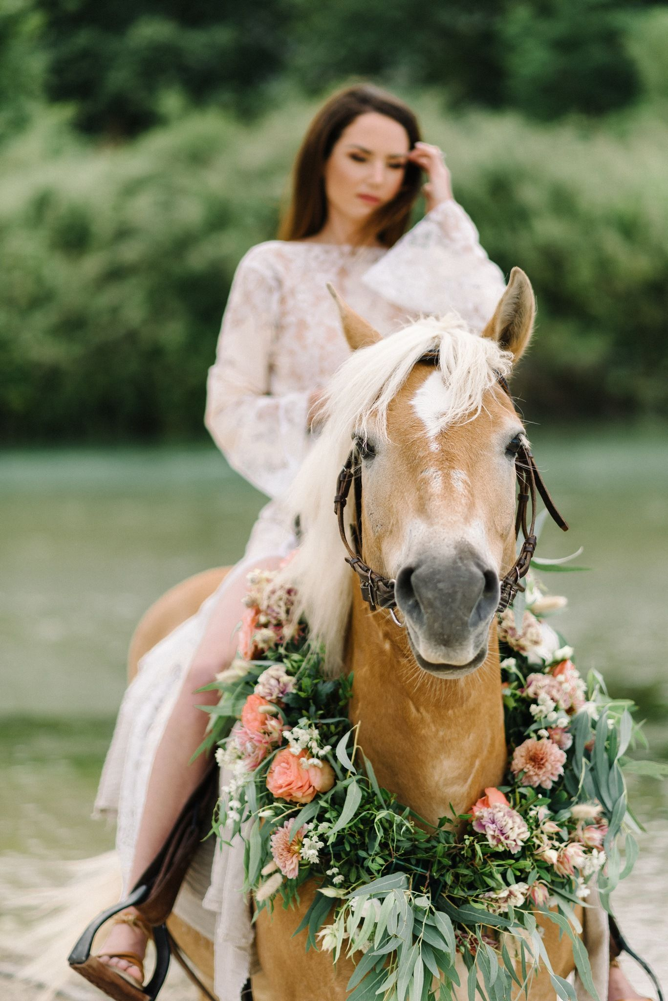 portrait of bride riding a horse in acheron river in greece