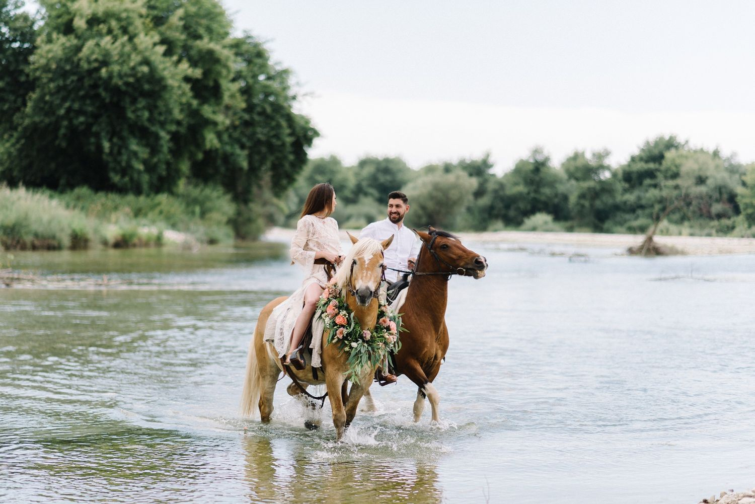 couple engagement shooting riding horses in acheron river greece