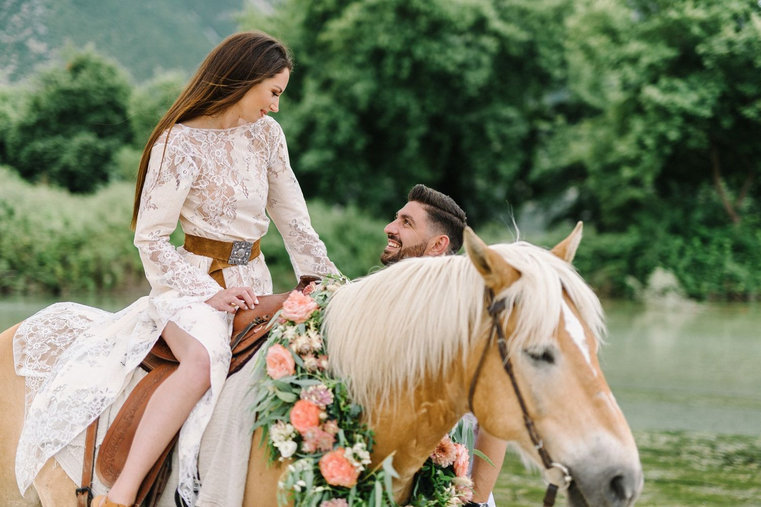 portrait of bride and groom riding a horse in acheron river in greece