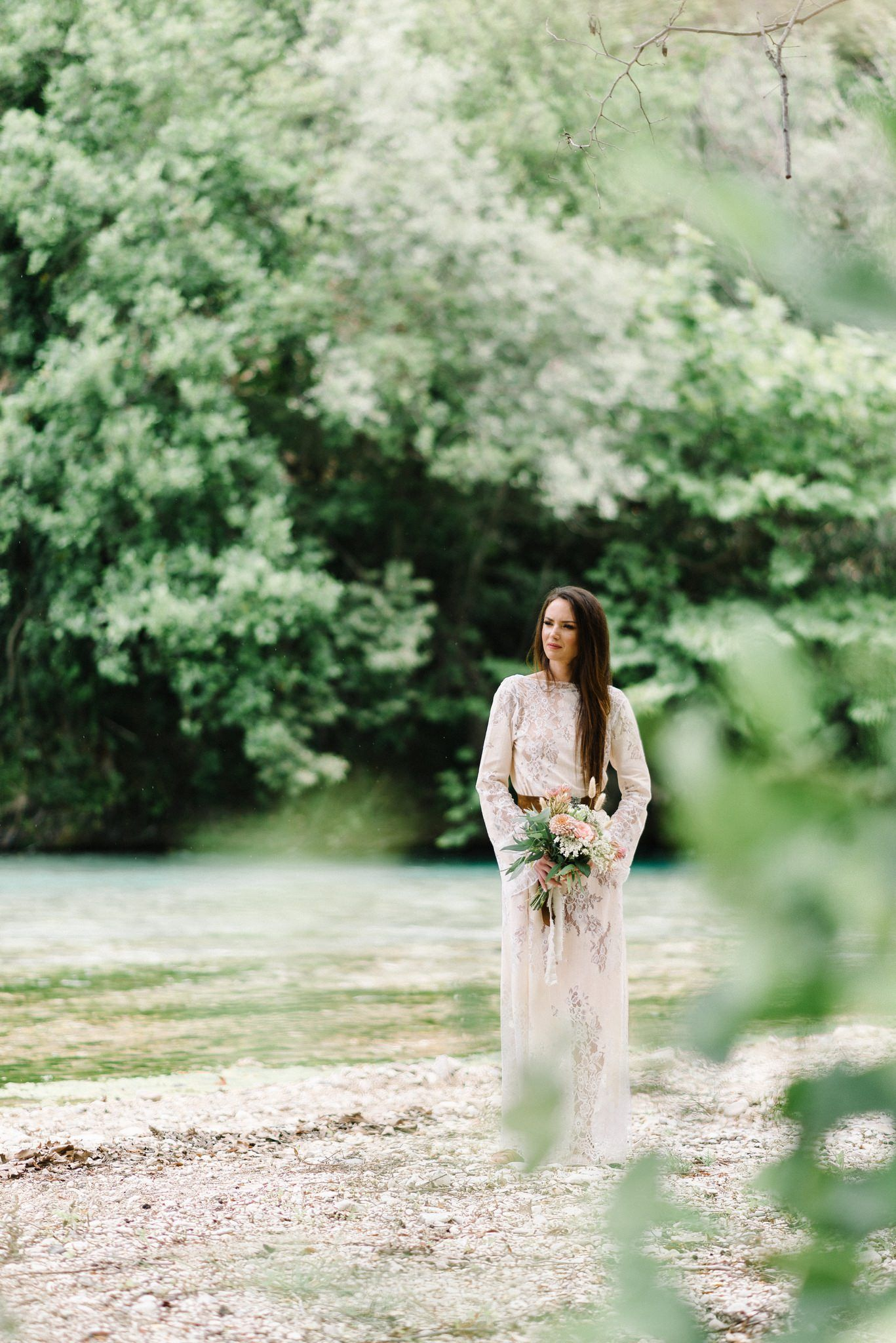 bride wearing nidodileda dress in acheron river