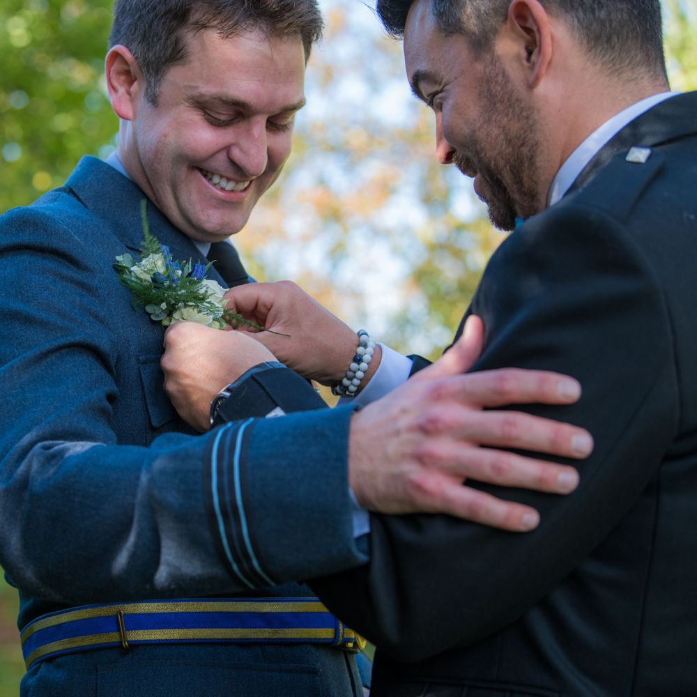 RAF groom pinning flowers, Long Crendon manor - Robert Nelson Wedding Photography