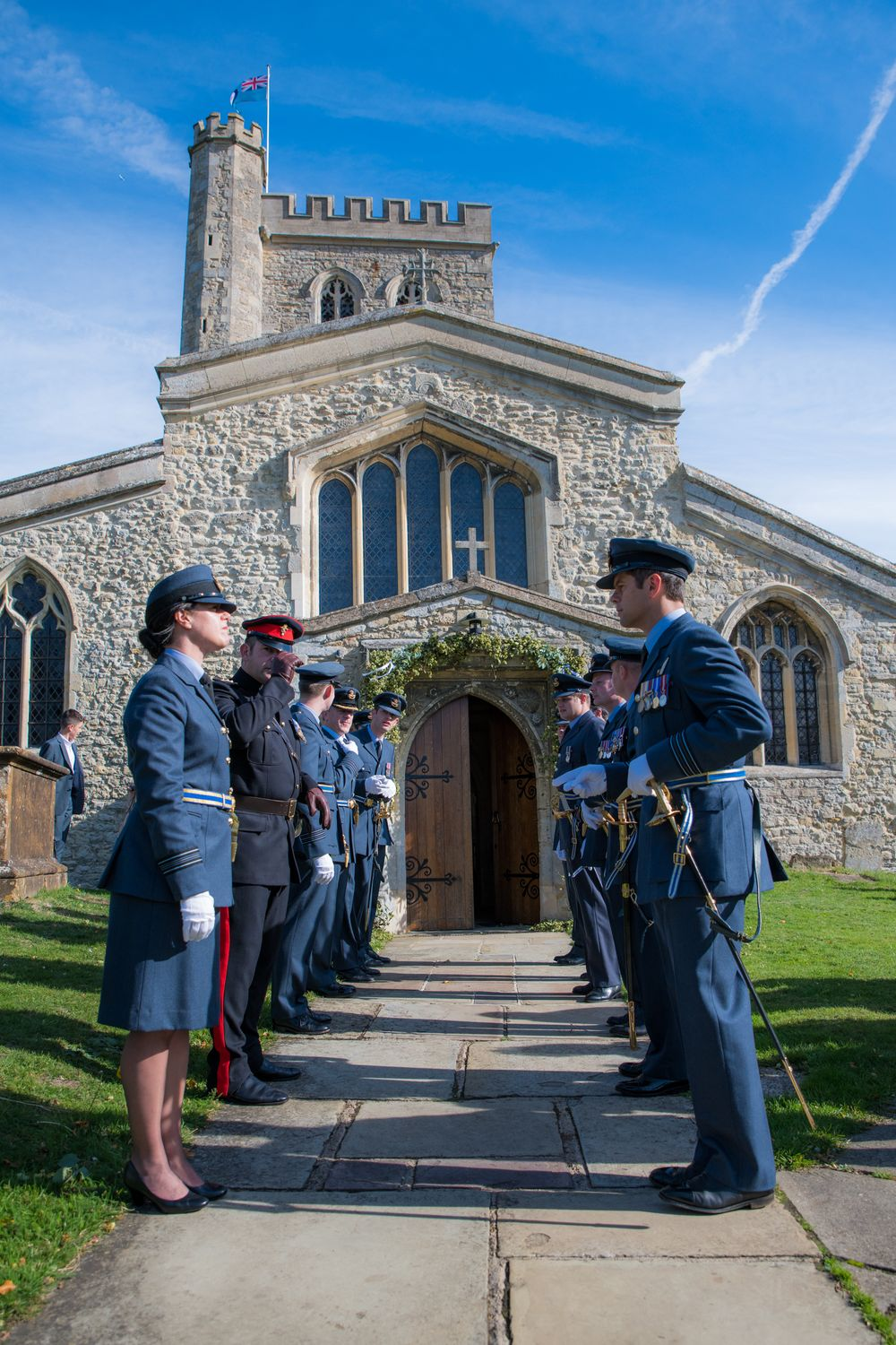 RAF soldiers lined up outside church wedding, Long Crendon manor - Robert Nelson Wedding Photography