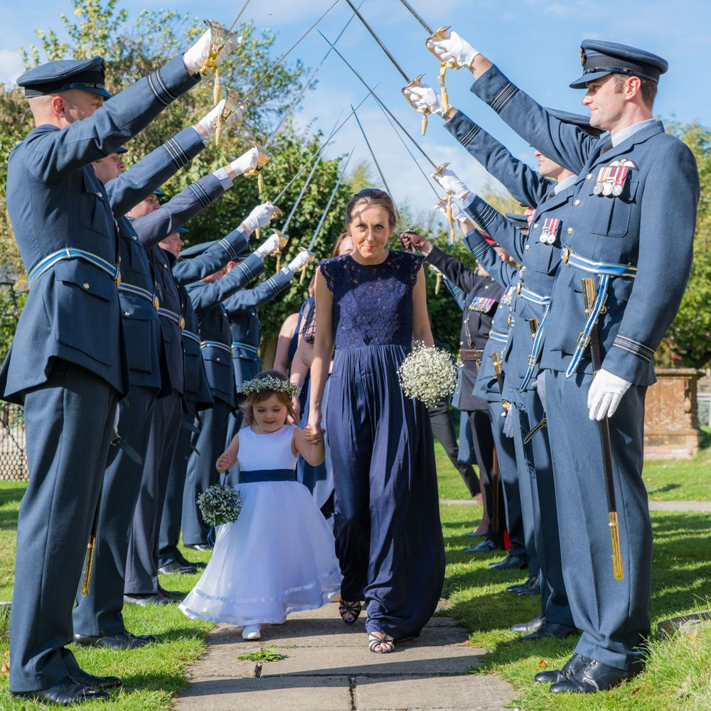 guests arriving at the RAF church wedding, Long Crendon manor - Robert Nelson Wedding Photography