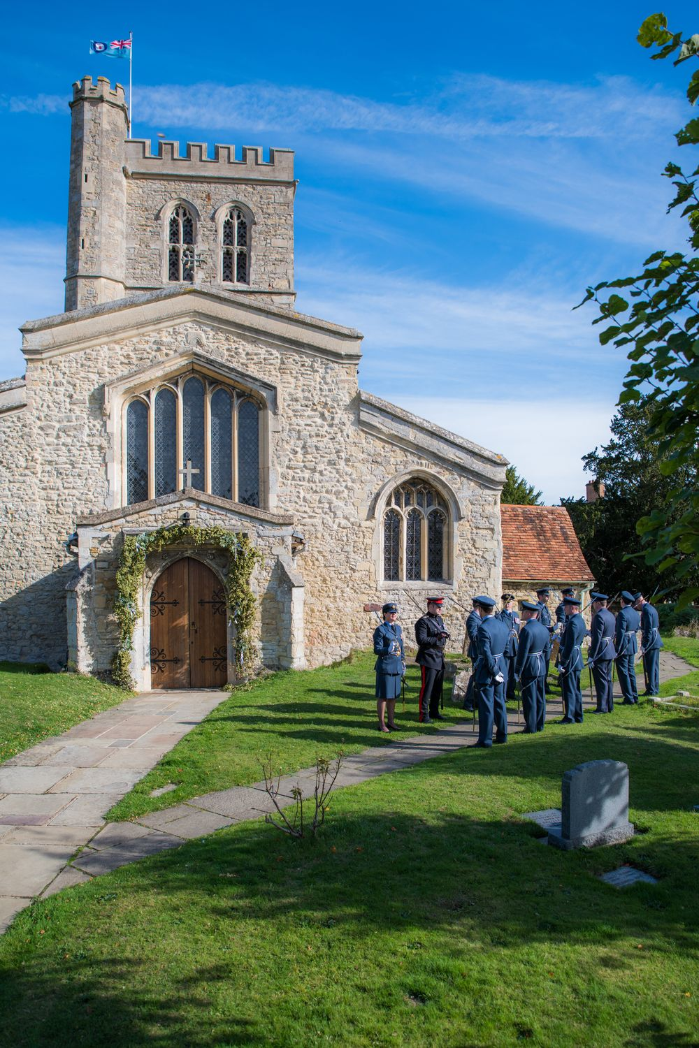 RAF soldiers lined up outside church for wedding, Long Crendon manor - Robert Nelson Wedding Photography