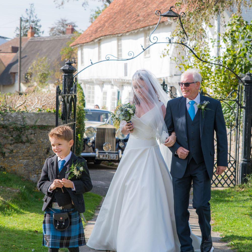 Bride arriving with father and son at wedding, Long Crendon manor - Robert Nelson Wedding Photography