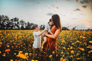 Boy mom Kate Rangel frolics with sons at golden hour in Raleigh North Carolina