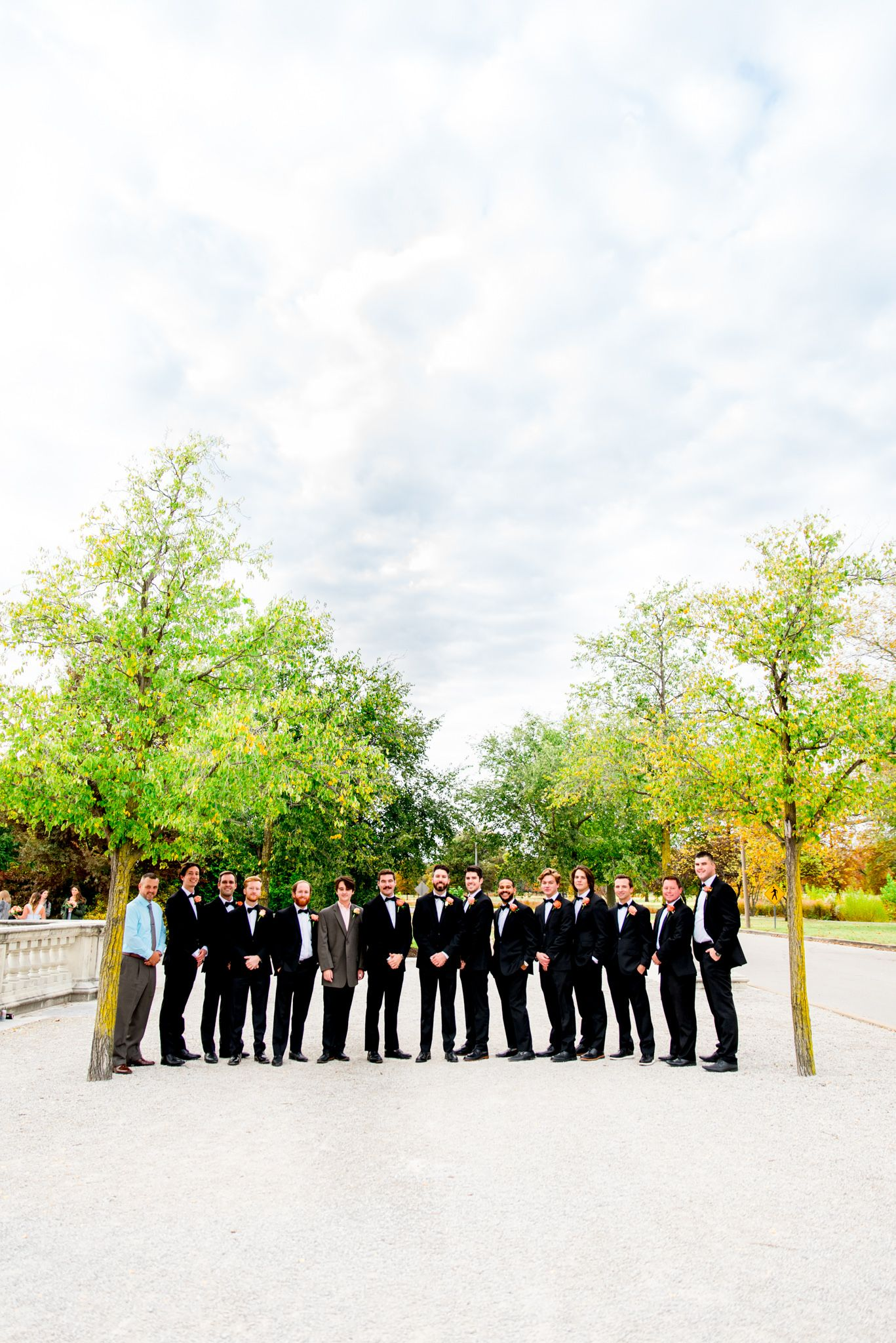 groom and groomsmen portraits at Forest Park STL fall wedding