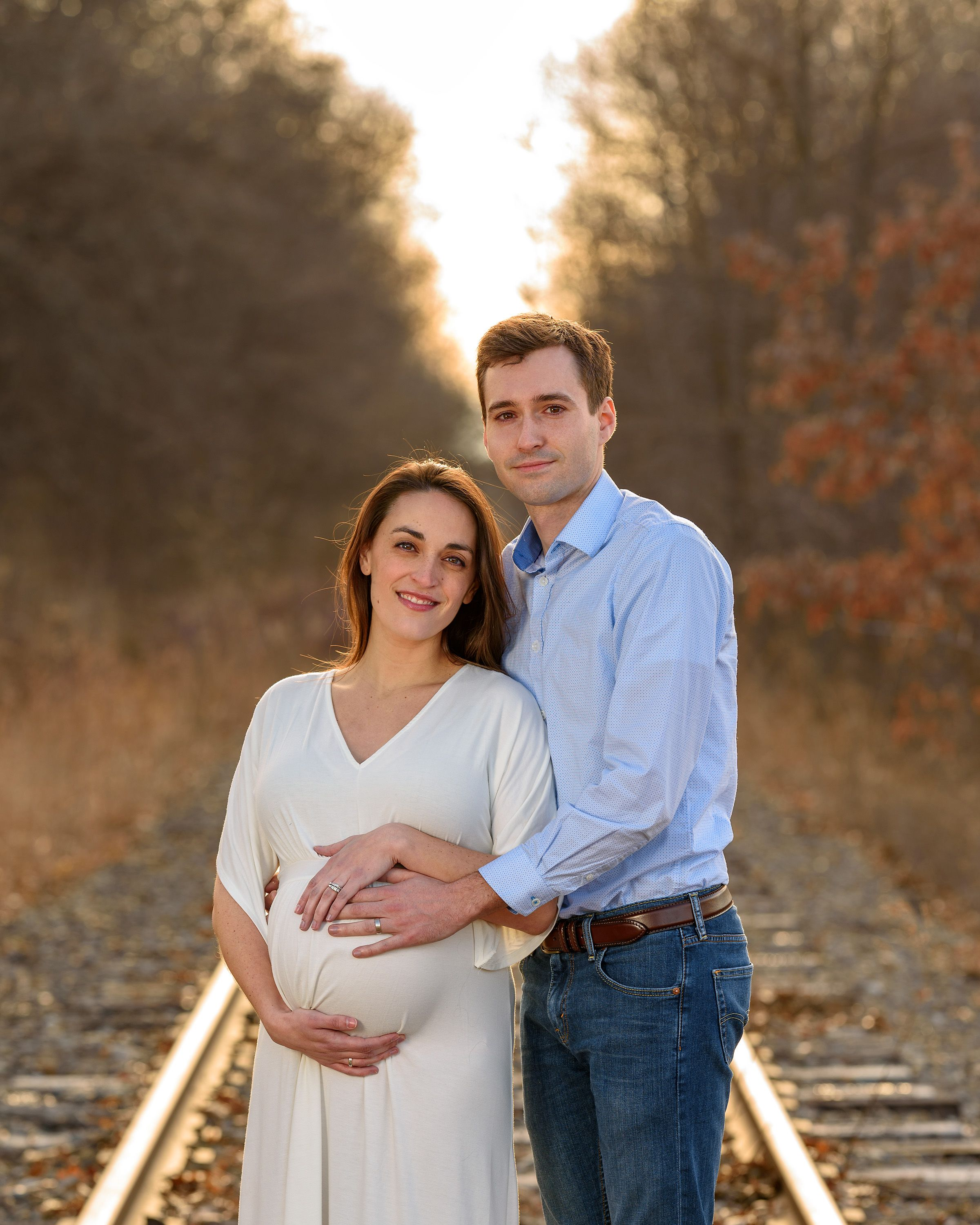 Couples maternity photo on deserted railbed