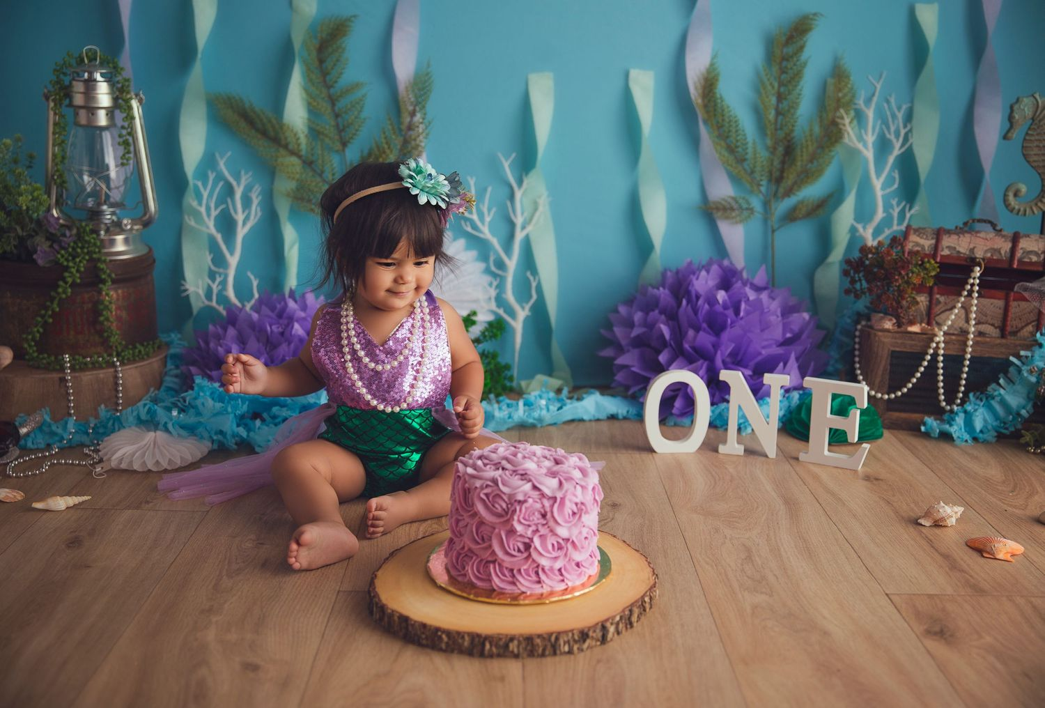 pink cake and happy baby girl mermaid themed session