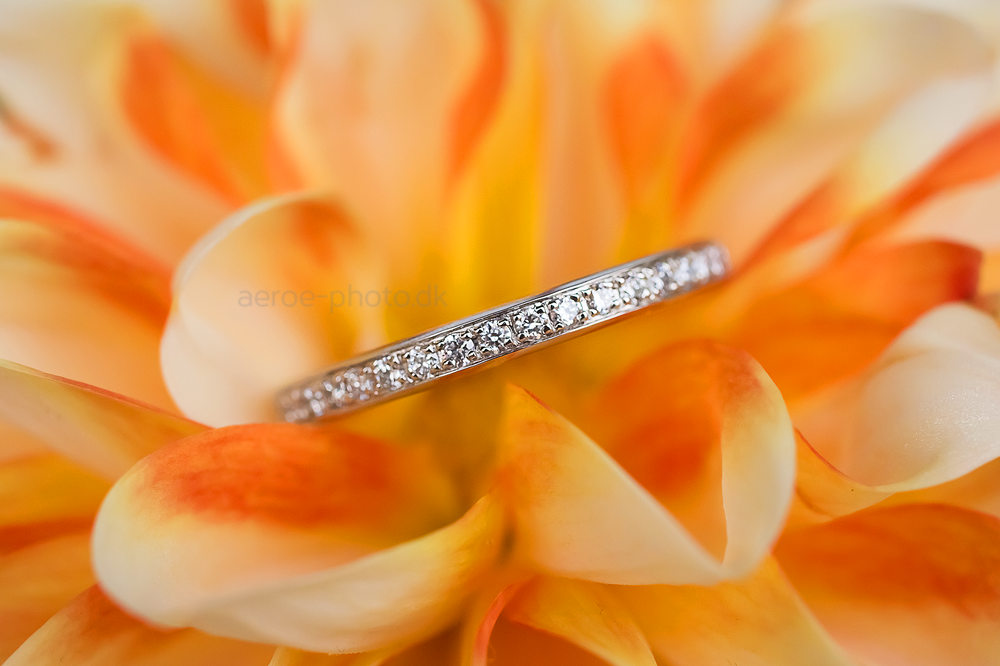 Beautiful flower and a beautiful wedding ring.