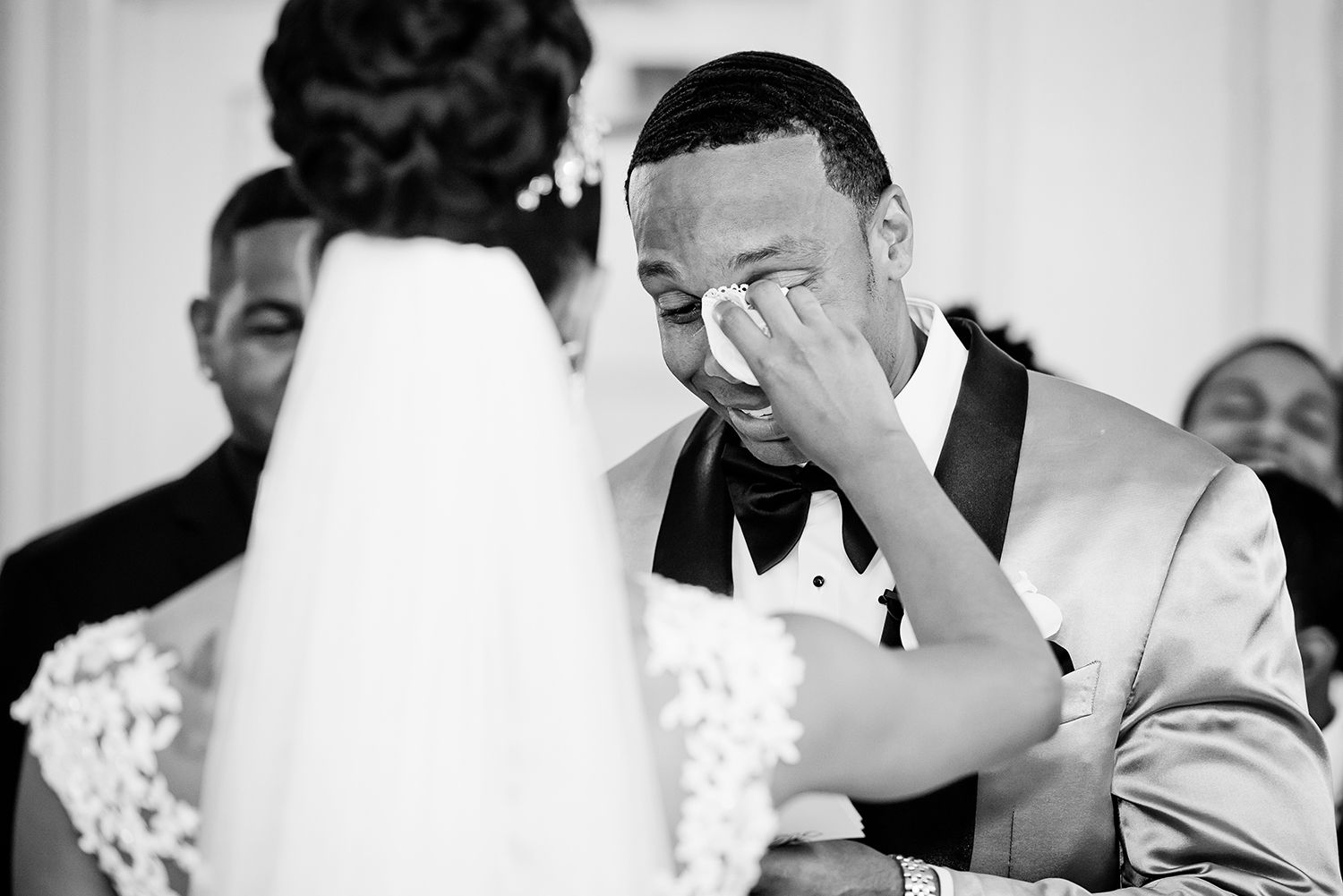 groom is crying during ceremony