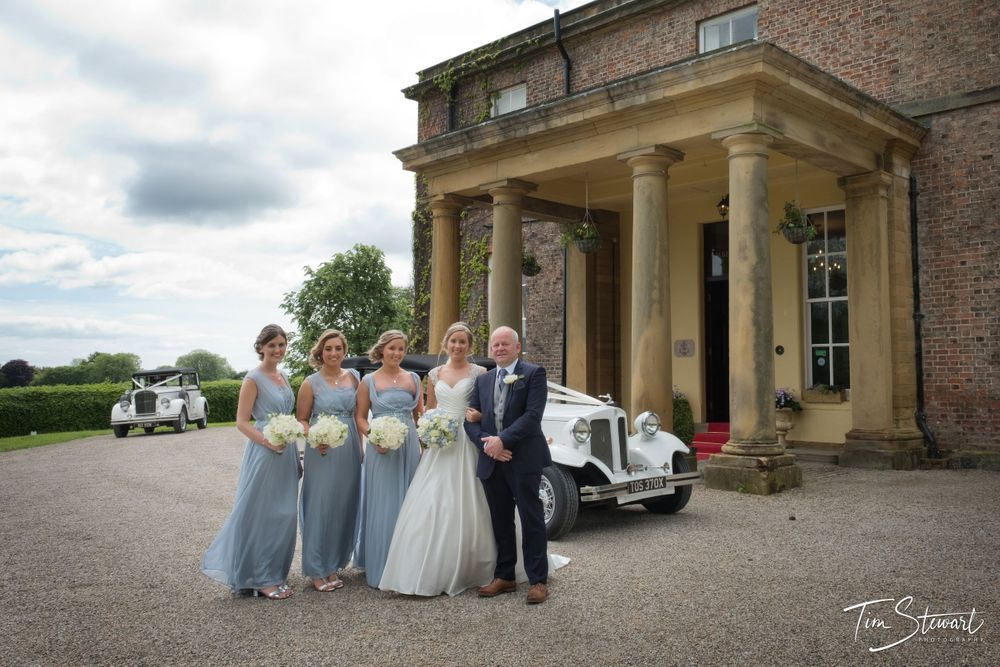 Solberge Hall wedding, bride and father with bridesmaids