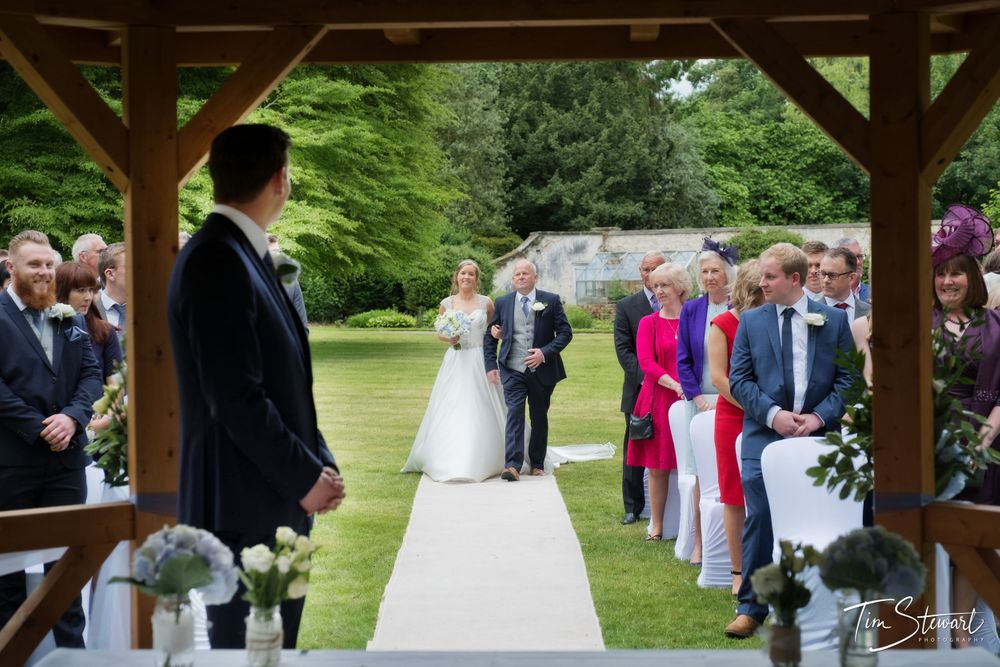 Solberge Hall, outdoor wedding, bride and father walking down the aisle.