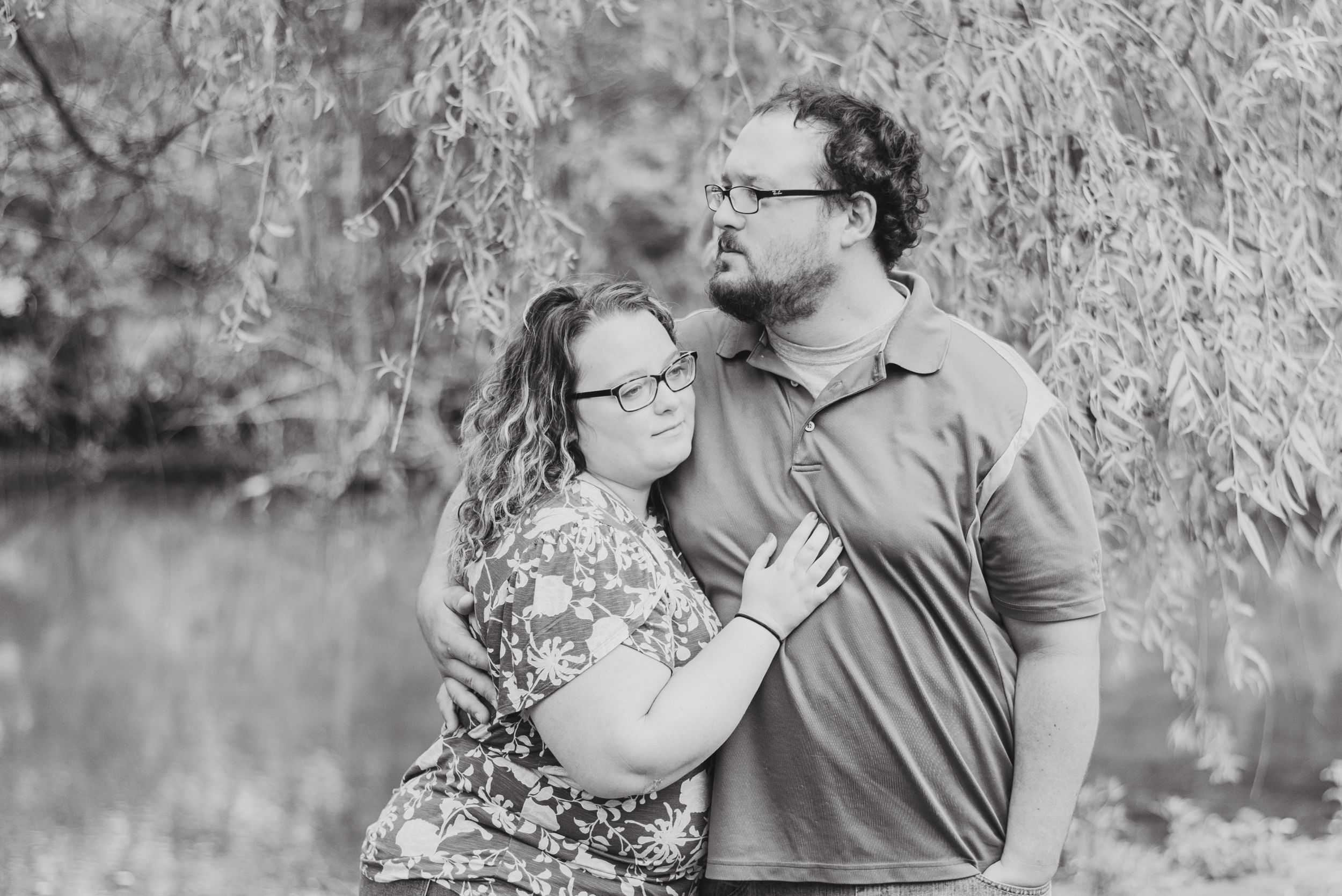 Couple standing under willow tree in black and white at Succop Conservancy in Butler Pennsylvania