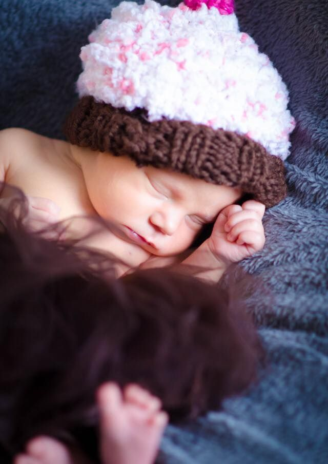 Baby Girl wearing cupcake hat