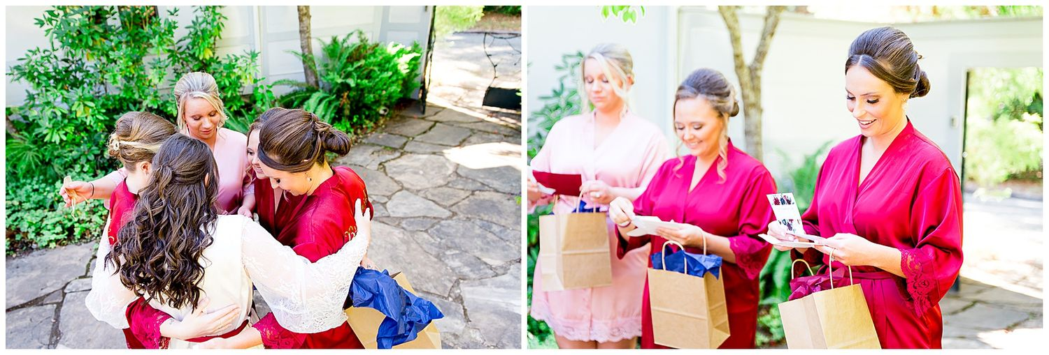 bridesmaids in red and blush robes opening gifts from their NorCal bride
