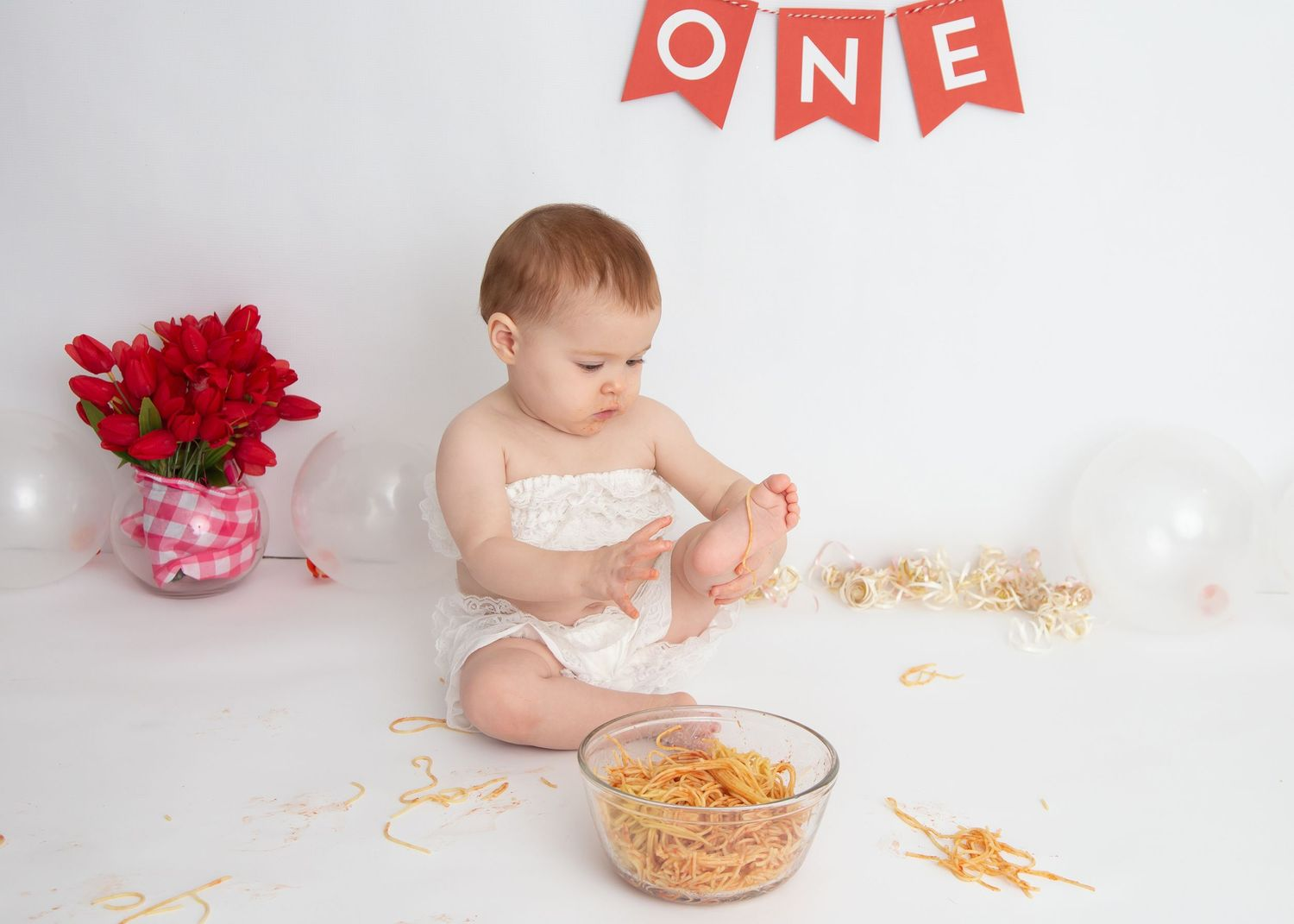 baby and spaghetti during one year photo session