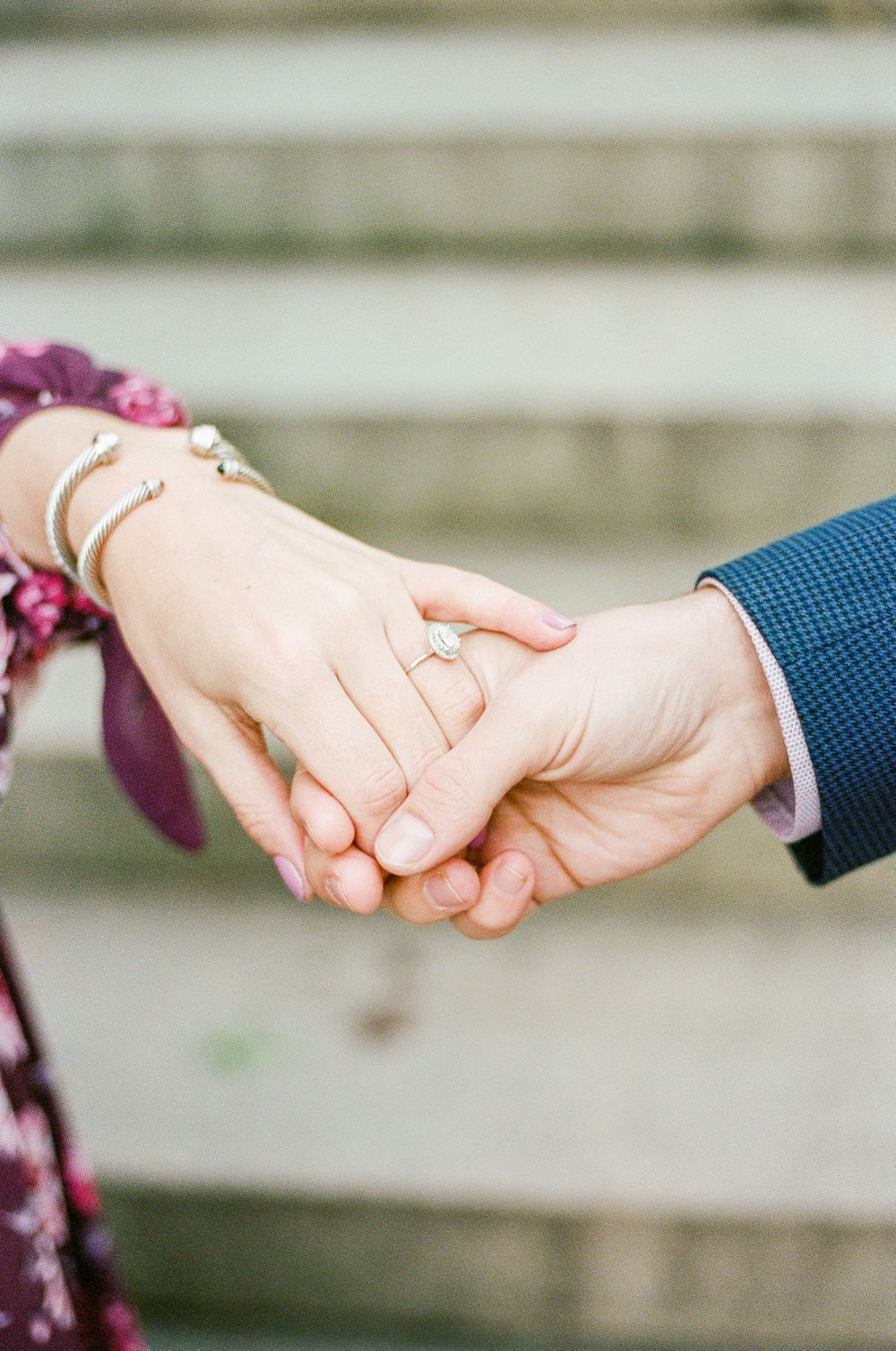 couple holds hands in central park in the middle of manhattan