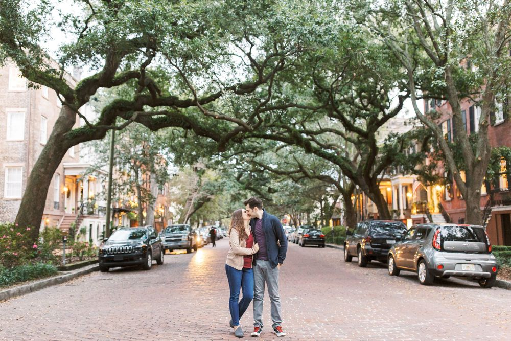 couple walking down jones street in savannah ga