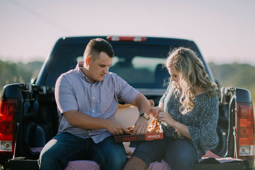 north sonoma mountain regional park engagement sunset couple in pick up truck couple eating marys pizza