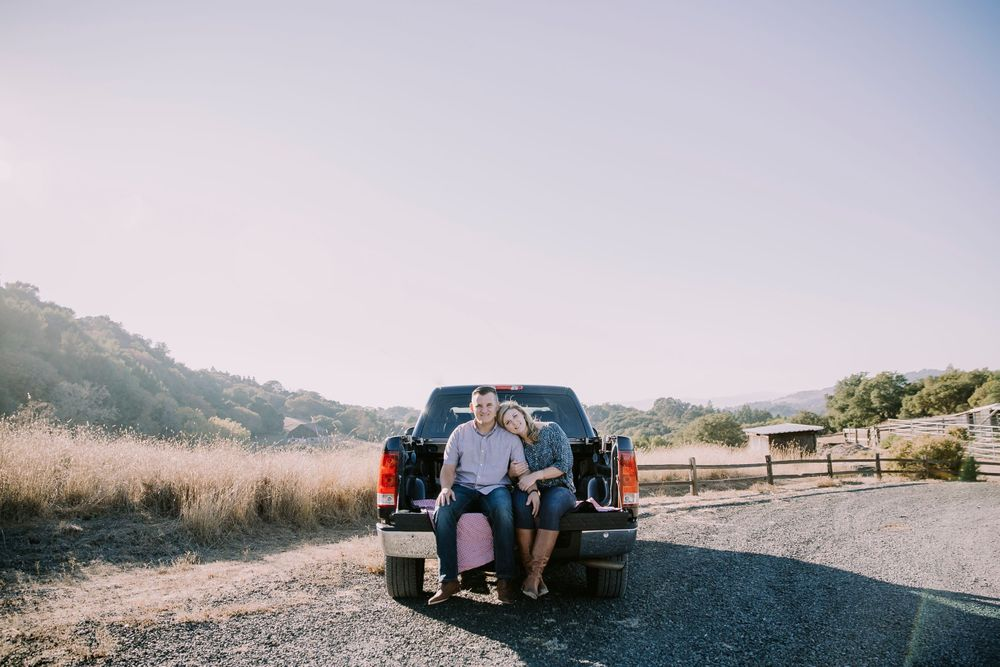 north sonoma mountain regional park engagement sunset couple in pick up truck smiling
