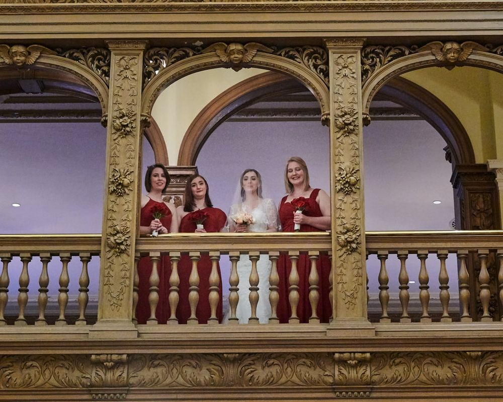 fairmount olympic hotel wedding bride and bridesmaids on balcony