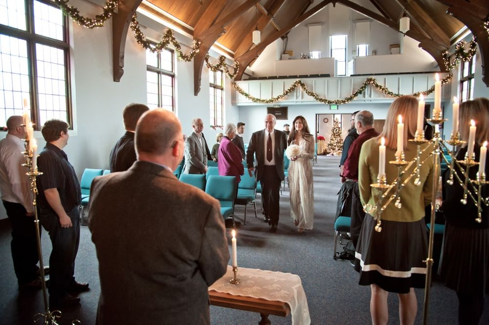 bride walking aisle during Christmas wedding ceremony in West Seattle