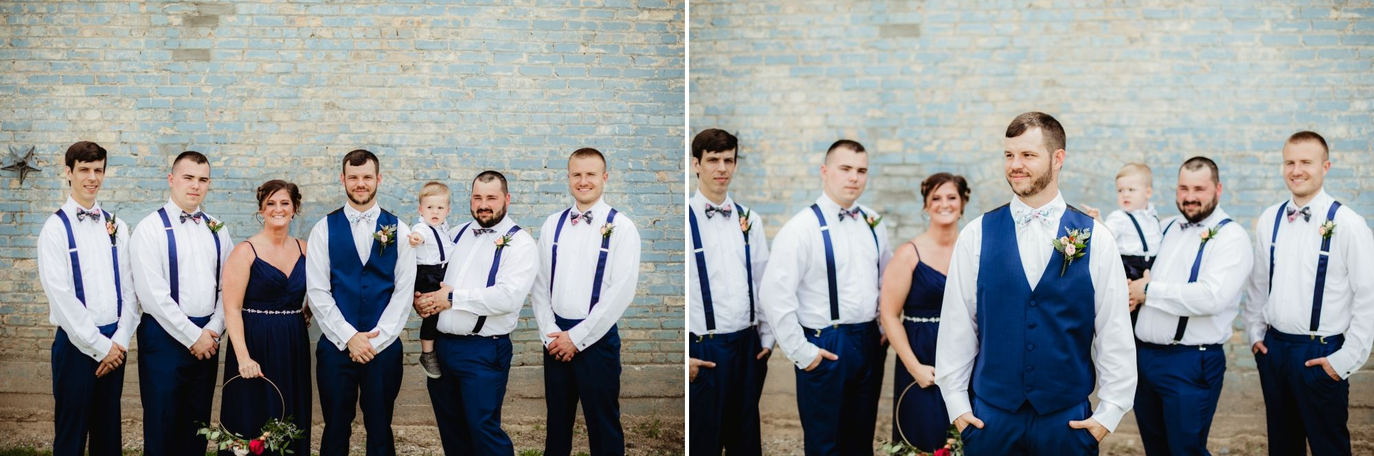 Groom, groomsman, one woman, and ring bearer in front of blue bricks. They're wearing navy and white.