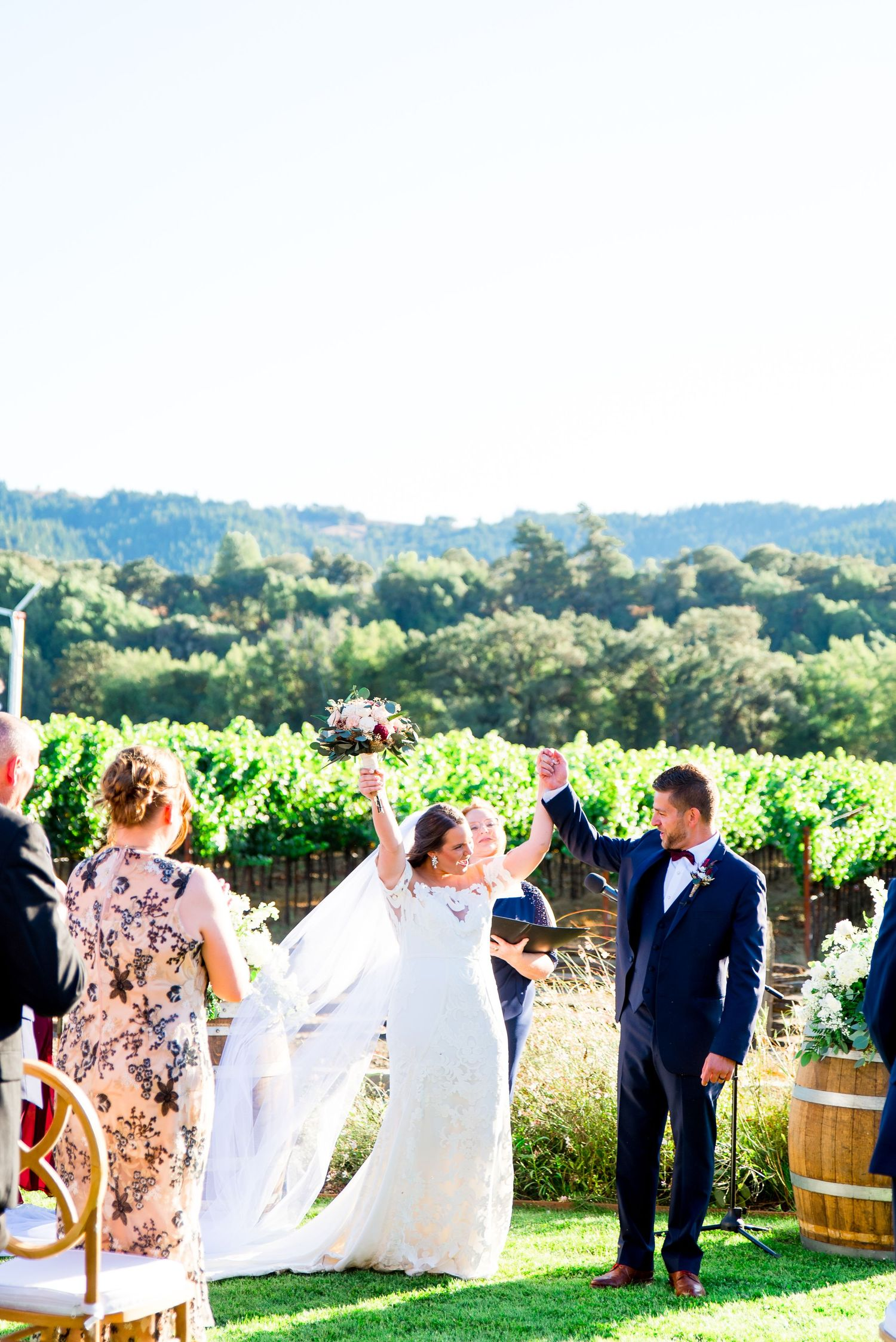 newlywed bride and groom cheering and walking down the aisle in Napa Valley California Pennyroyal Farm