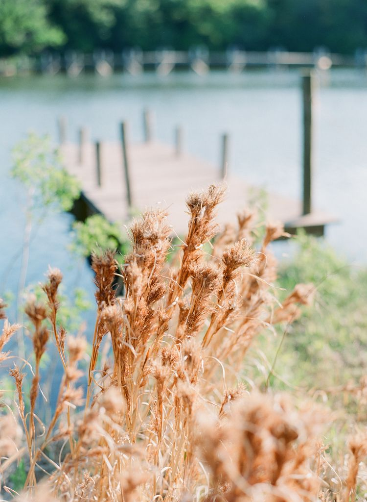 Oklahoma wedding engagement photographer engagements Aaron Snow Photography country lake summer couple dock grass
