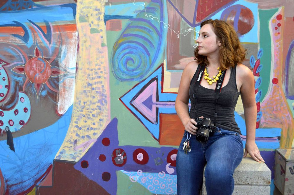 Colorado Springs Boudoir Photographer Elise Odom Portrait in front of a beautiful graffiti wall in a Downtown alley way