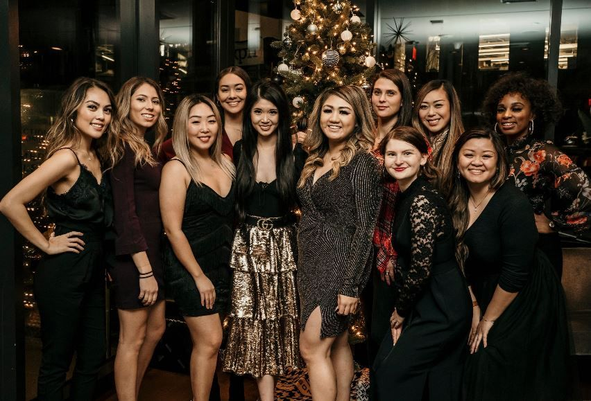 Women posing at holiday party in Seattle Washington