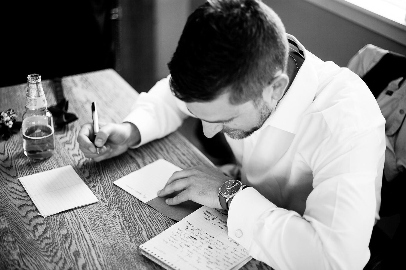 groom writing letter to bride on wedding day in Northern California