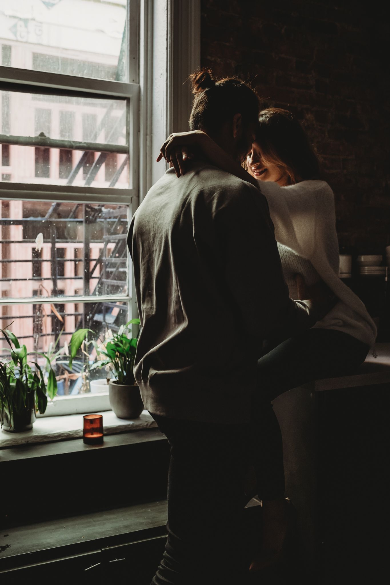 man and woman cuddle in kitchen at loft in seattle for couples photo, Issaquah, WA by Shutterbabe Snaphots