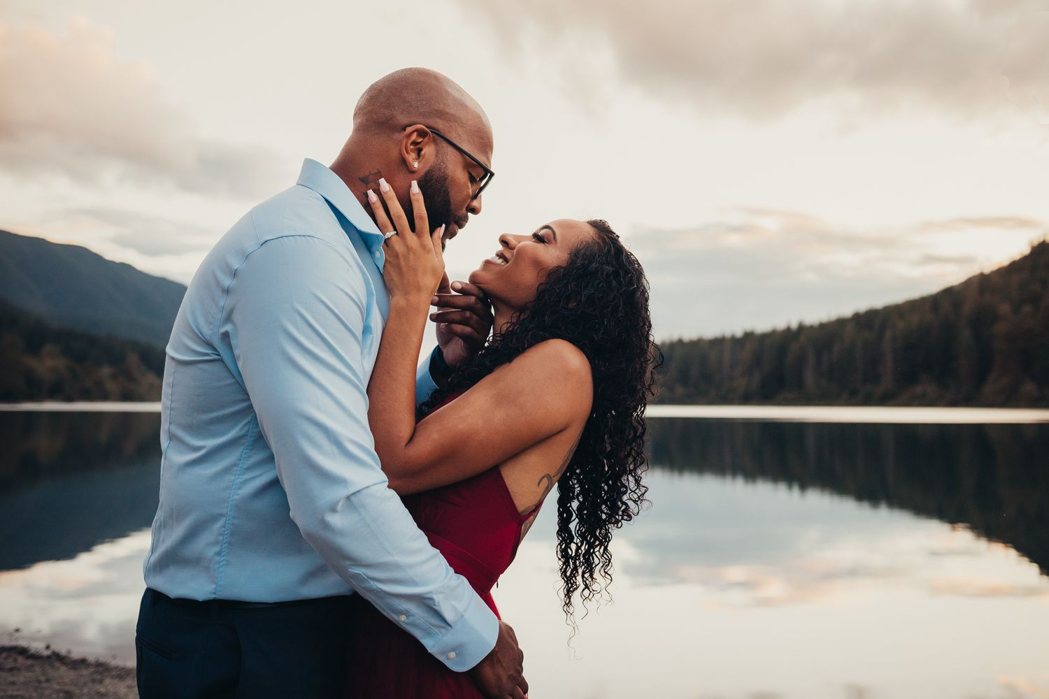 a man and woman embrace in front of rattlesnake lake for engagement photography, issaquah wa by shutterbabe snapshots