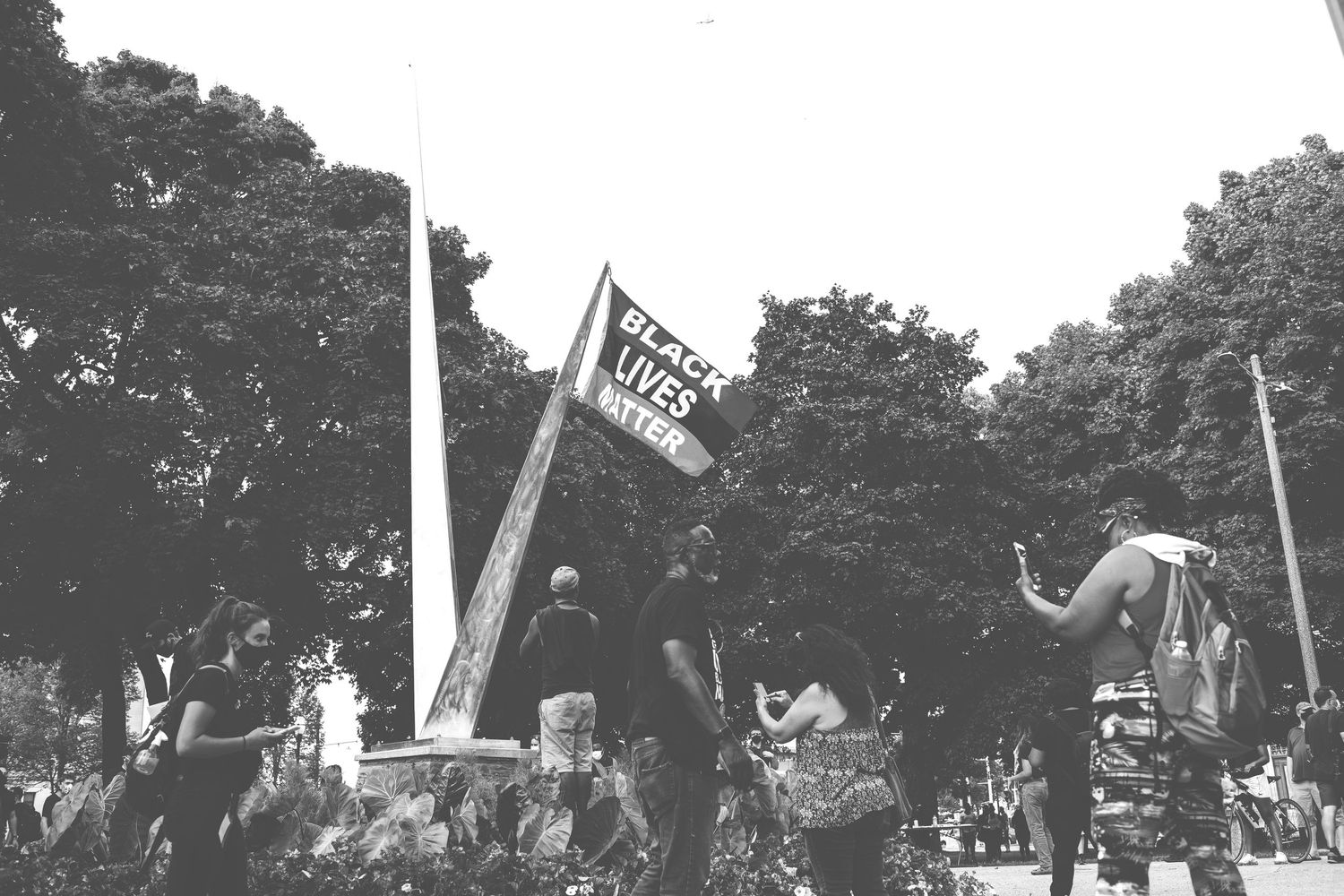 A Black lives matter flag is hung from a sculpture in Civic Center Park in Kenosha, WI.