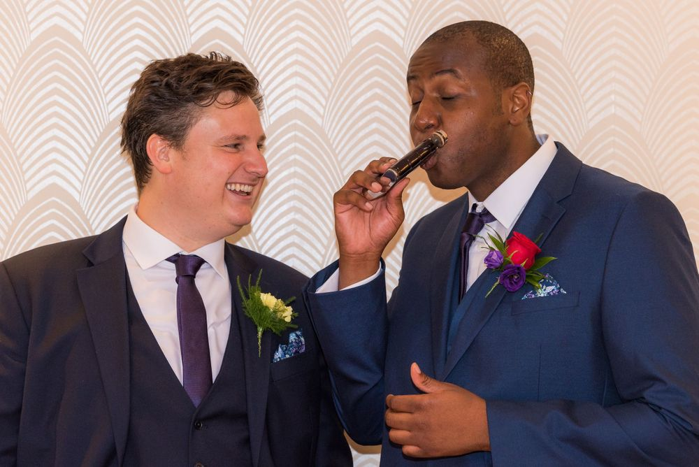 groom and best man drinking at Bromley Court Hotel